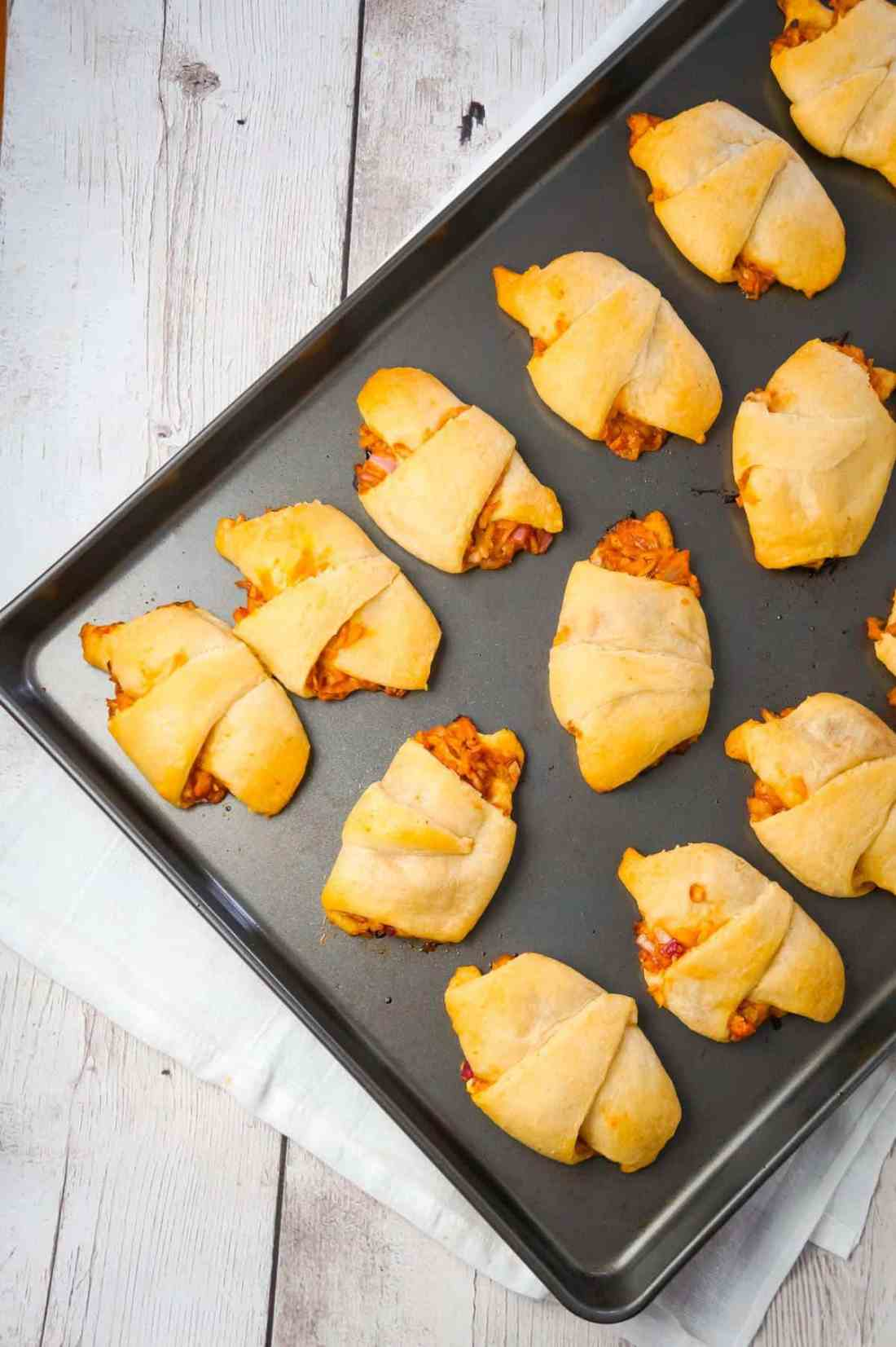 BBQ Chicken Crescent Rolls are an easy weeknight dinner recipe using shredded rotisserie chicken, diced red onions, Sweet Baby Ray's Barbecue sauce, shredded cheese and Pillsbury crescent rolls.