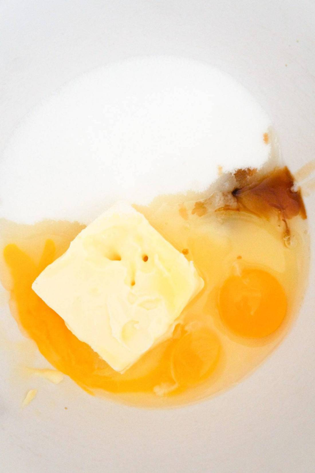 sugar, softened butter, eggs and vanilla extract in a mixing bowl