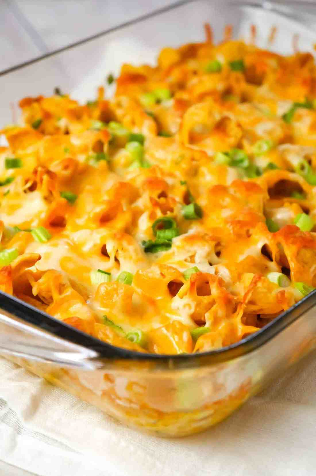 Buffalo Chicken Frito Pie is an easy casserole recipe using shredded rotisserie chicken and diced celery tossed in Buffalo sauce and ranch dressing, all topped with Fritos corn chips and cheese.