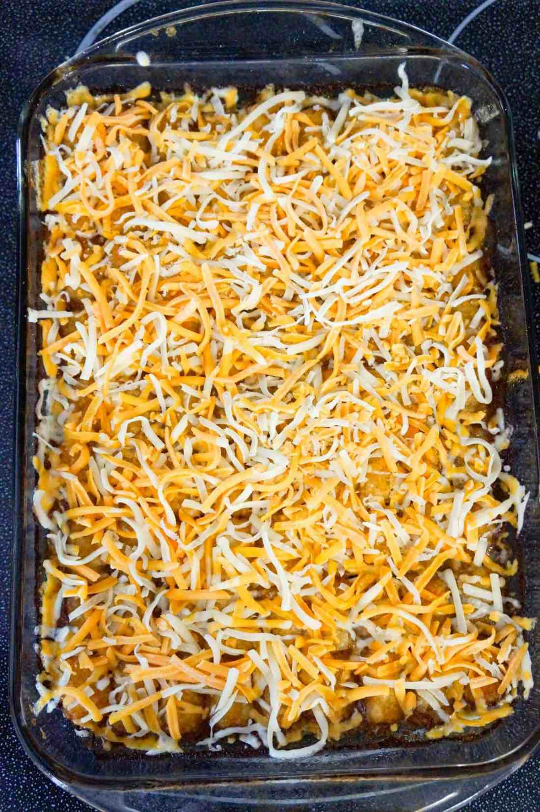 shredded mozzarella and cheddar cheese on top of tater tot casserole