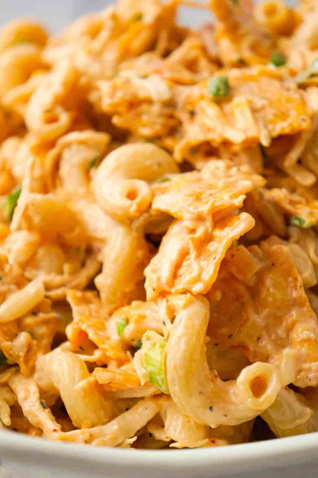 Doritos Chicken Pasta Salad is a tasty cold side dish recipe loaded with shredded chicken, chopped green onions, ranch dressing, salsa, shredded cheese and crumbled Doritos.