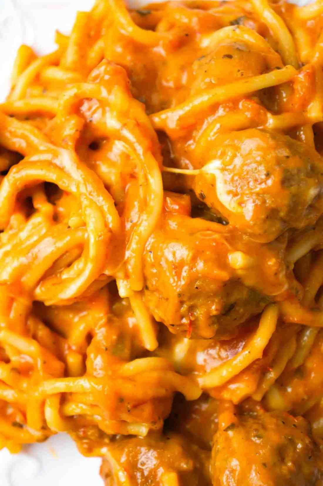 Instant Pot Cheesy Spaghetti and Meatballs is an easy and delicious pressure cooker pasta recipe loaded with Italian meatballs, shredded mozzarella and cheddar cheese and marinara sauce.