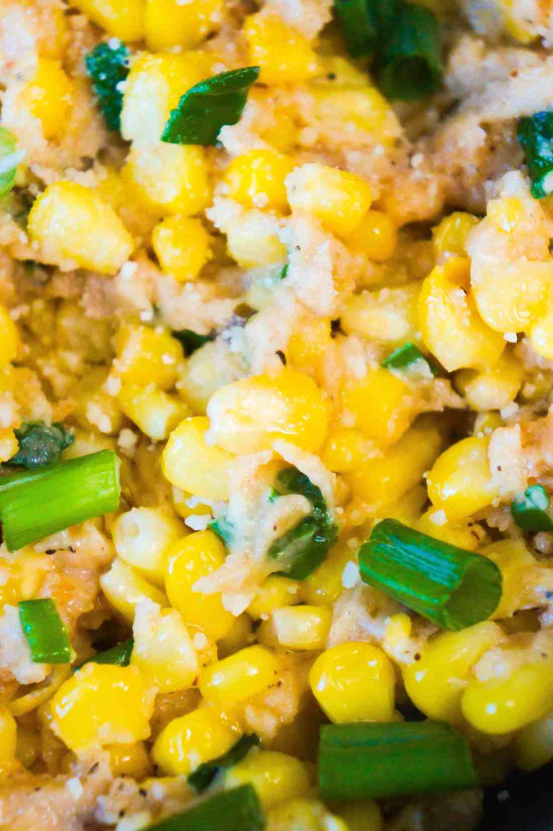 Corn side dish with green onions and Swiss cheese.