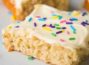 Banana Sugar Cookie Bars are an easy dessert recipe using only five ingredients. Sugar Cookie mix and ripe bananas form the base of these cookie bars which are topped with vanilla icing and colourful sprinkles.