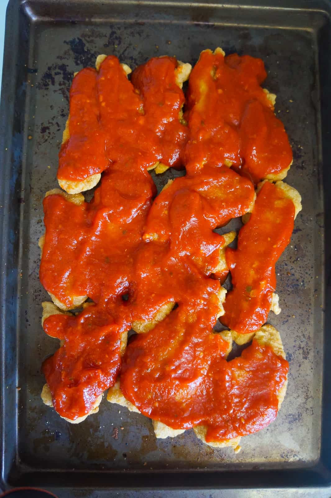 chicken fingers covered with marinara sauce