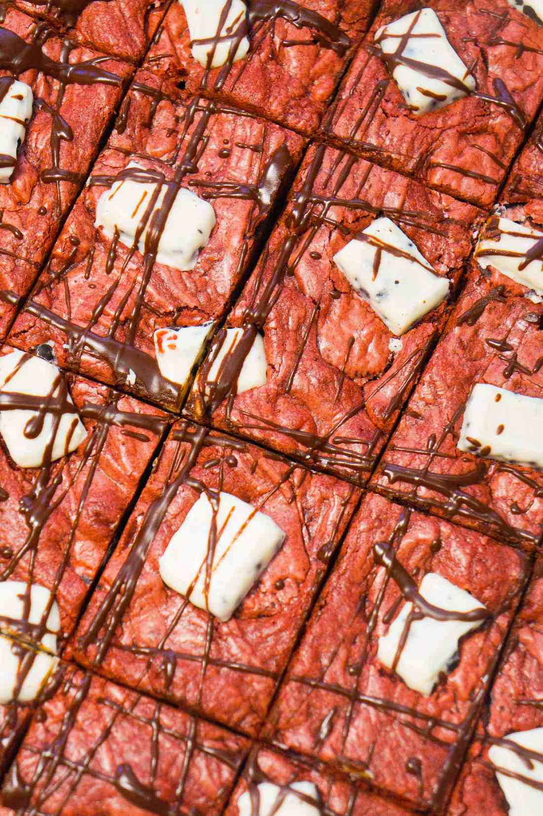 Easy red velvet cookie bars made with cake mix and loaded with mini Oreos.