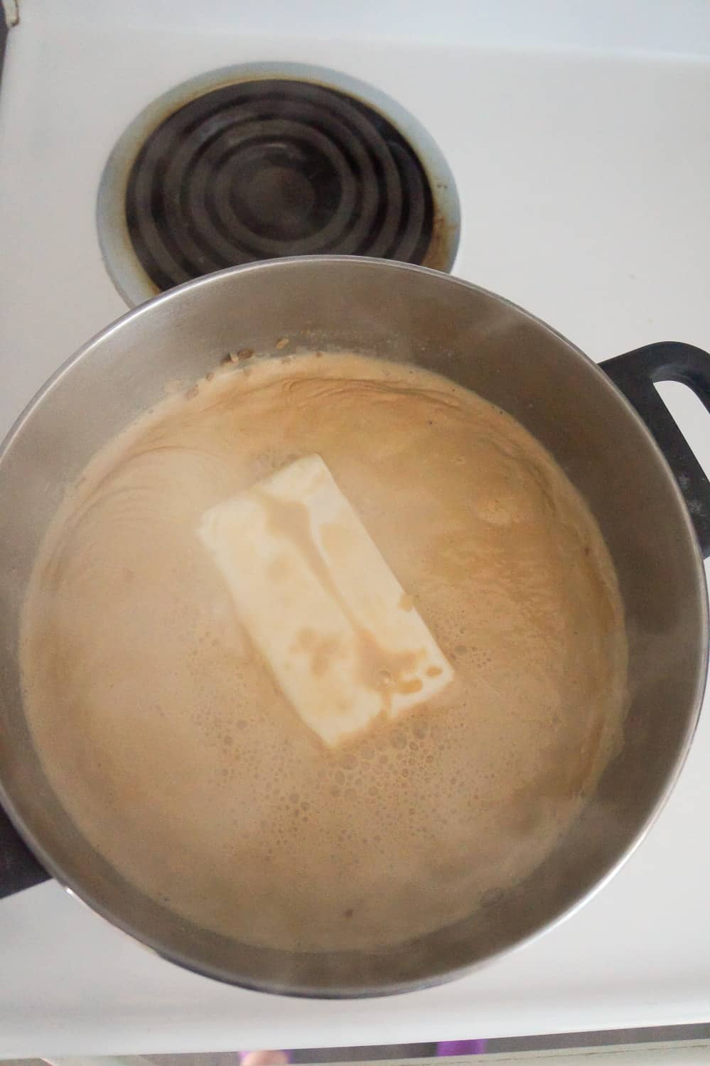 cream cheese brick added to onion soup in large saucepan