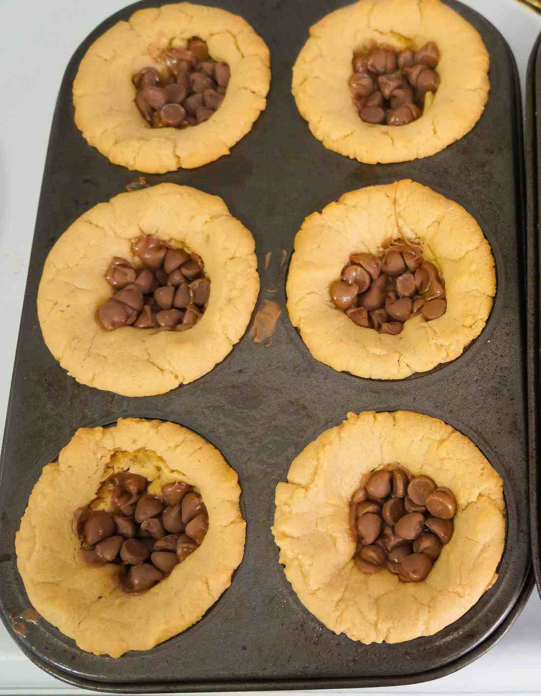 peanut butter cookie cups filled with chocolate chips