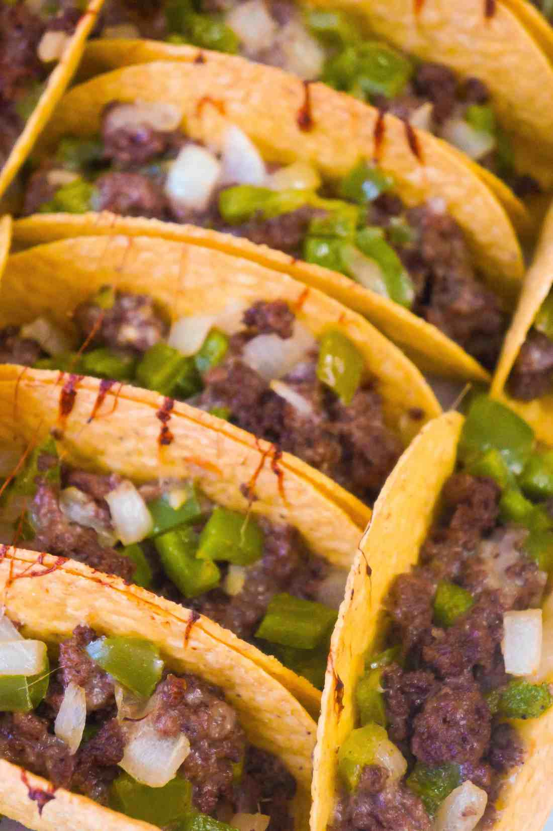 Philly Cheese Steak Ground Beef Tacos are loaded with onions, green peppers and mozzarella cheese.