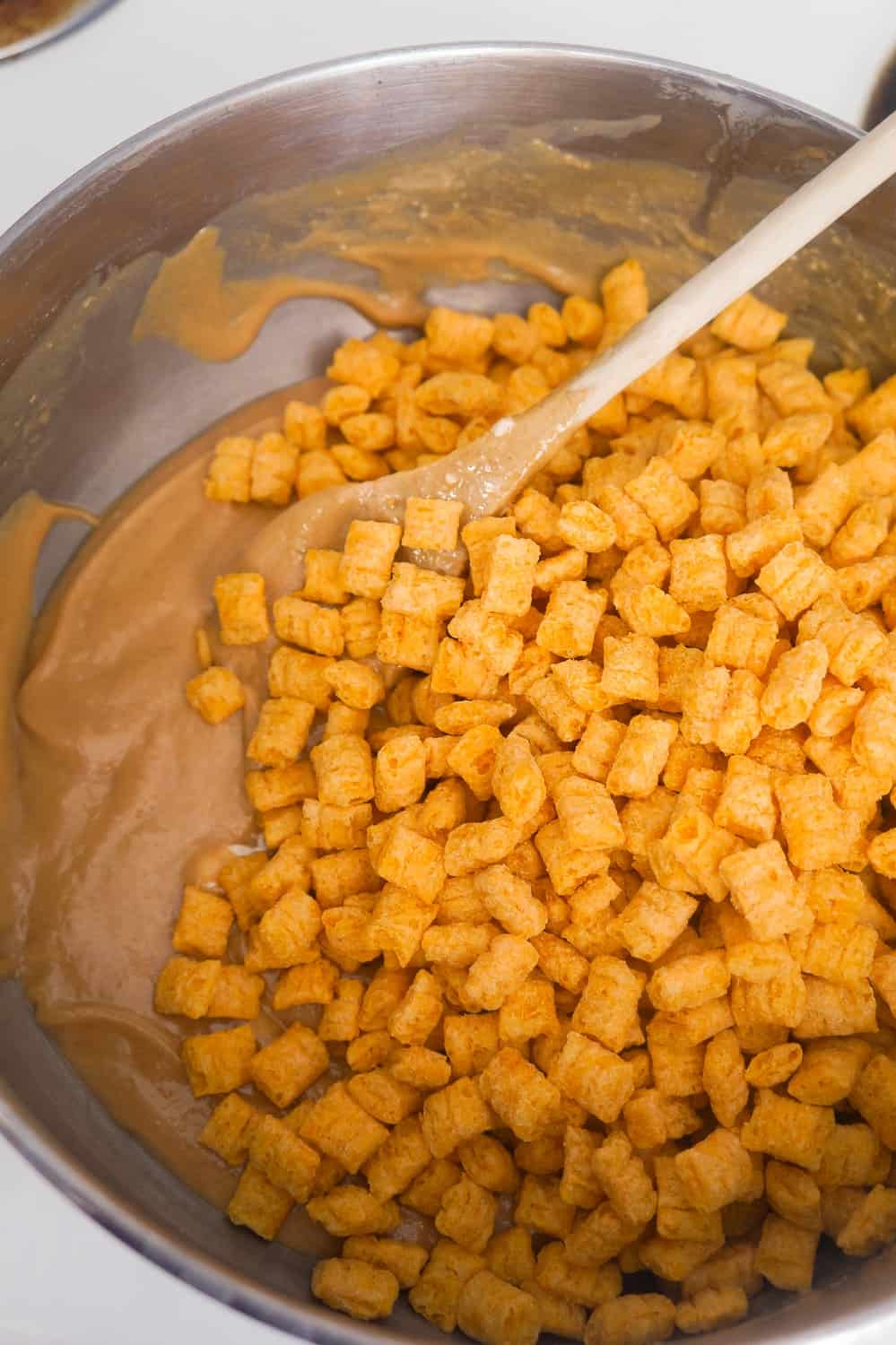 captain crunch cereal in melted peanut butter marshmallow mixture