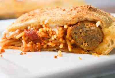 close up spaghetti and meatballs stuffed pizza recipe