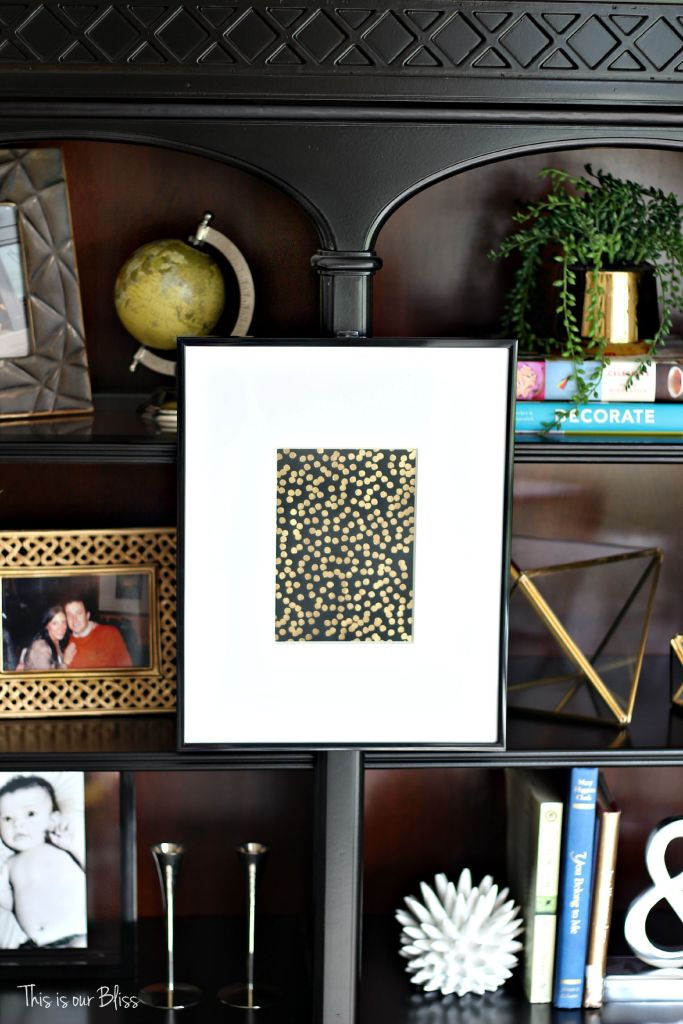 how to update an old bookcase with command hooks - 30 second makeover - formal living room bookcase - hanging art on a bookcase - shelf styling 3 - This is our bliss