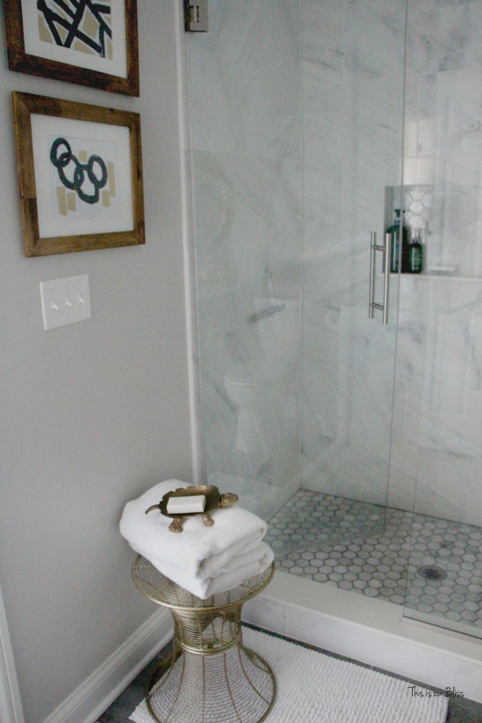 Basement bathroom reveal Marble shower hexagon shower tile | neutral bathroom decor | black, white gold and gray | glam bathroom || This is our Bliss