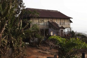 A former British colonial administration building with a covered stairway looks out over the bay from the Hill Station neighbourhood of Sierra Leone's capital Freetown