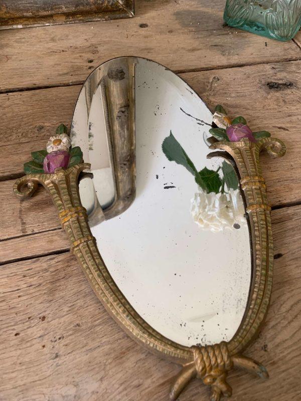 ancien miroir en fonte glace biseauté décor de fleurs