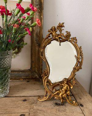 ancien miroir en bronze à poser décor d'anges glace biseautée 1900