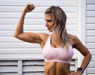 Woman flexing bicep
