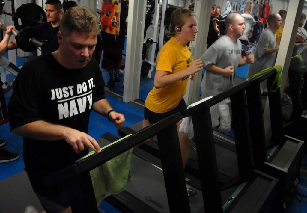 People doing cardio on treadmill