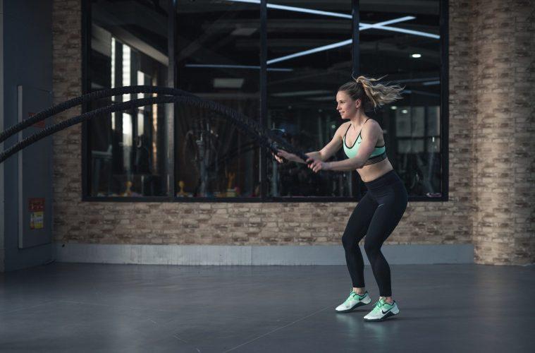 Girl doing battle ropes HIIT