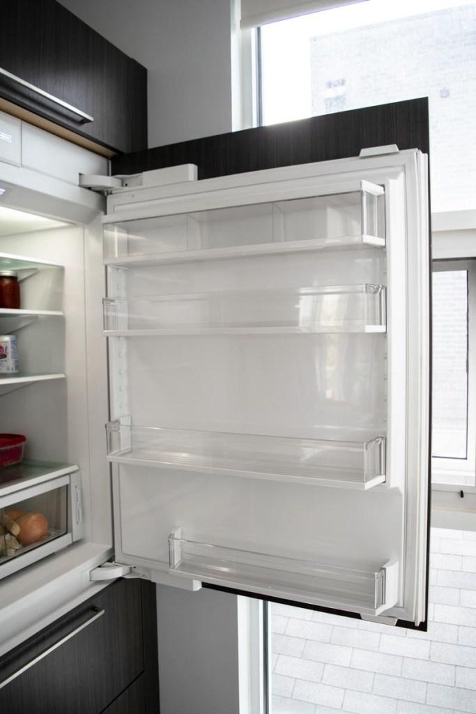A clean and empty fridge door