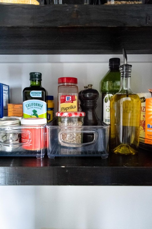 Organized pantry items in bins while spring cleaning your pantry