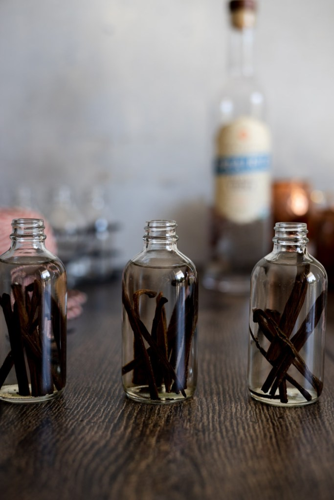 Vodka poured over vanilla beans for homemade vanilla extract