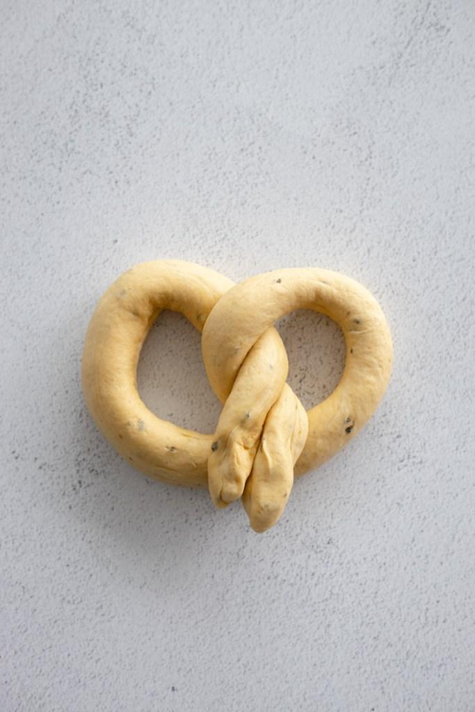 One pretzel ready to boil
