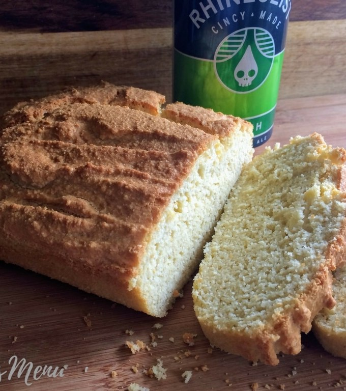Beer Bread is one of my all time favorite quick breads. Served warm and smeared with butter it is pure perfection! This bread is super easy, low in carbs and is a great addition to any meal. The beer flavor is present but definitely not over powering, so it pairs well with many different cuisines. #beerbread #keto #stpatricksday #ketobread