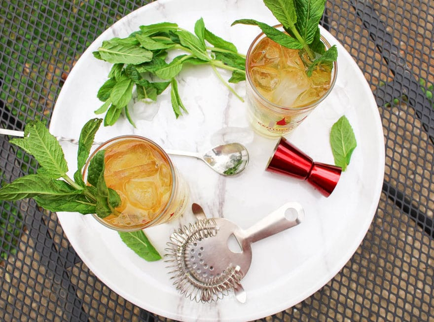 The Mint Julep has been the traditional beverage of the Kentucky Derby and Churchill Downs for almost a century. You can join in the festivities completely guilt free with this Mint Julep recipe. It's completely sugar free, has only about 100 calories and zero carbs! #mintjulep #sugarfreecocktail #kentuckyderby