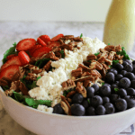 This Red, White and Blue Summer Salad is one of my all time favorite summertime side dishes! The combination of the sweet berries, with the salty feta cheese and tangy dressing will have your taste buds singing. Serve it as a side dish at summer barbecues or add some cooked and diced chicken to make it a complete meal.
