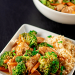 Low carb Chinese chicken and broccoli in a square white bowl on a black back ground