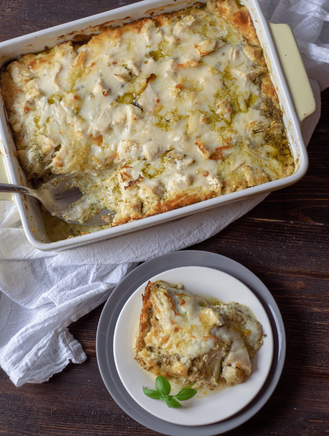 A casserole of low carb chicken pesto lasagna with zucchini noodles