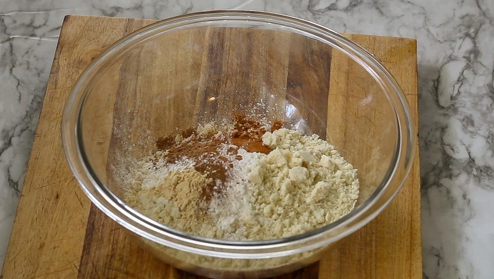 A glass bowl full of the ingredients for keto pumpkin scones