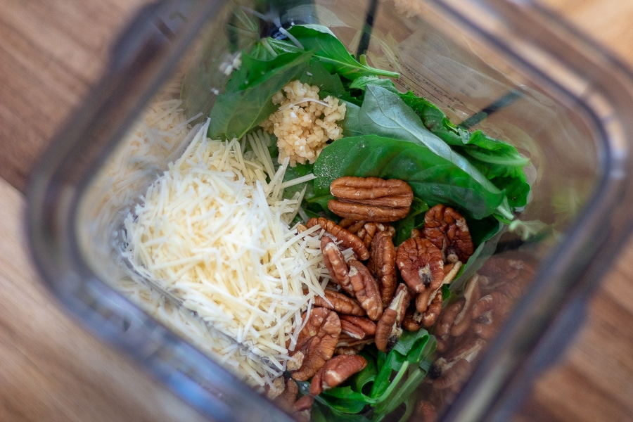 basil, Parmesan cheese, pecans and garlic in a blender