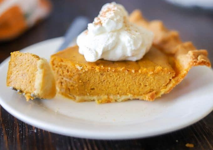 a slice of keto pumpkin pie in a keto pie crust