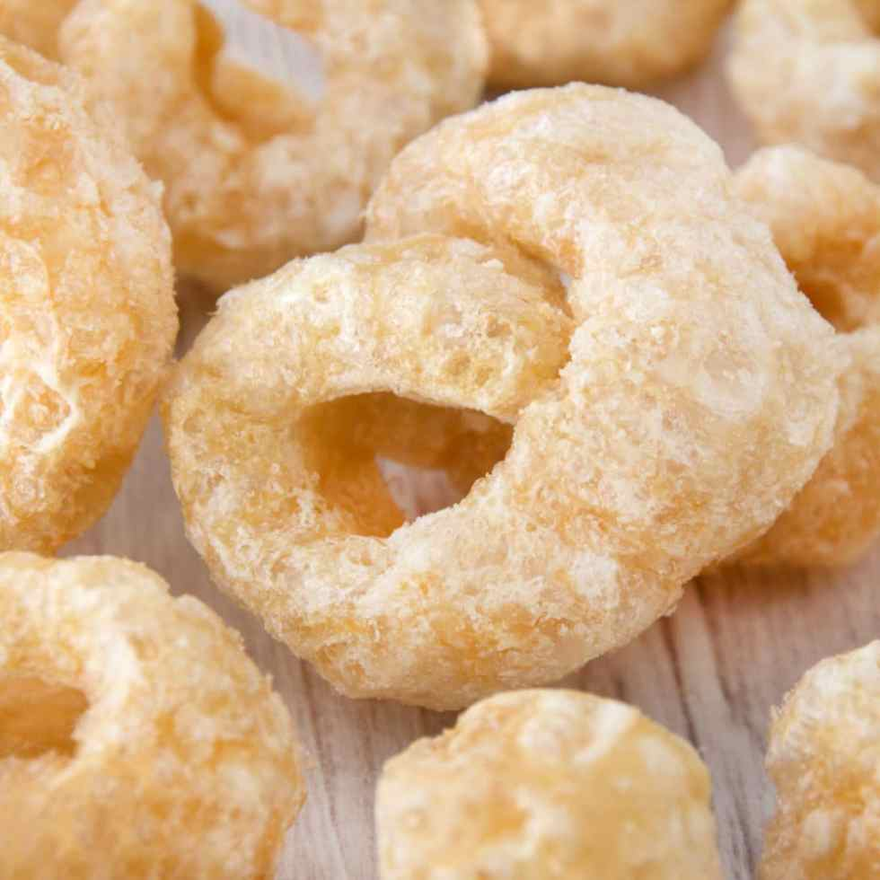 Close up image of a pork rind with a white background