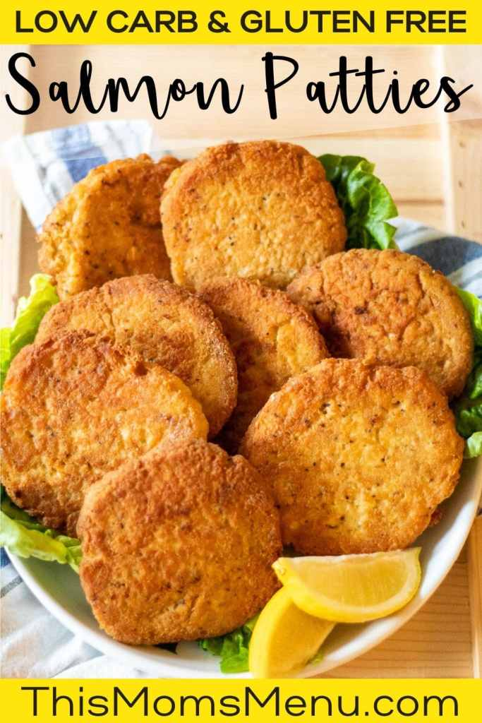 a white plate full of low carb salmon patties and lemon wedges with text overlay