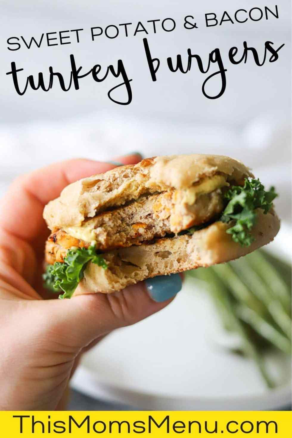a single turkey burger on on english muffin with dijon mustard and lettuce, bing held out after one bite has been taken with descriprive text overlay.