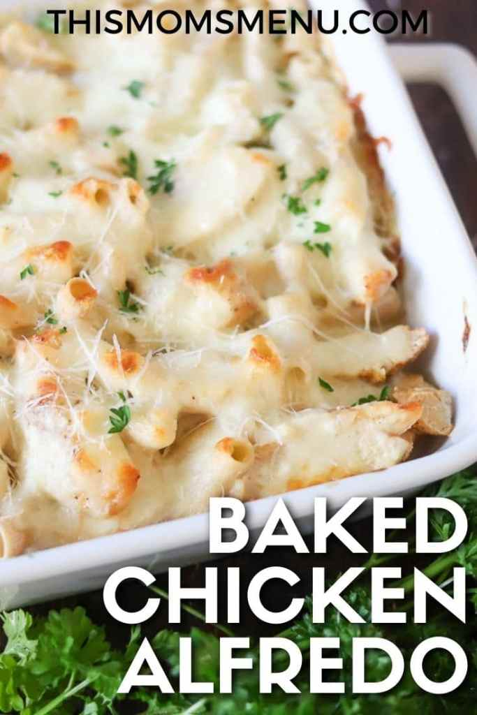 "A close up of Chicken Alfredo Casserole baked in a white dish and topped with fresh parsley and a white text overlay that says ""Baked Chicken Alfredo"""