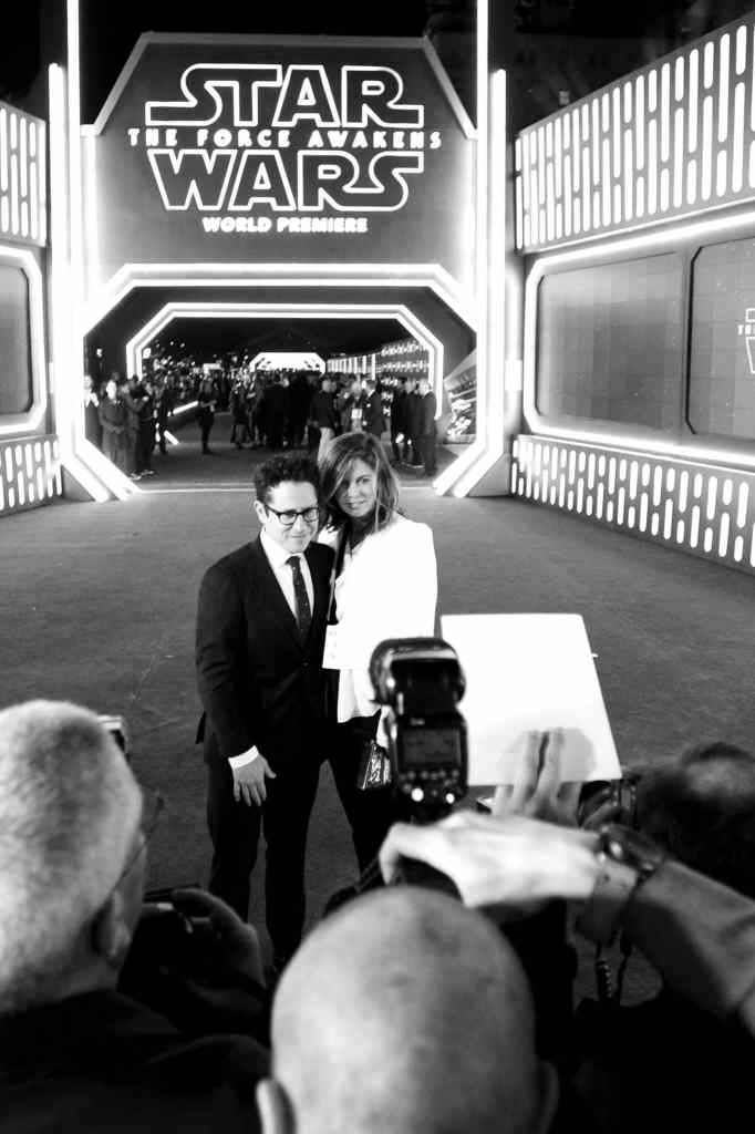 HOLLYWOOD, CA - DECEMBER 14: (EDITORS NOTE: Image has been shot in black and white. Color version not available.) Director J.J. Abrams (L) and Katie McGrath attend the World Premiere of ?Star Wars: The Force Awakens? at the Dolby, El Capitan, and TCL Theatres on December 14, 2015 in Hollywood, California. (Photo by Charley Gallay/Getty Images for Disney) *** Local Caption *** J.J. Abrams;Katie McGrath