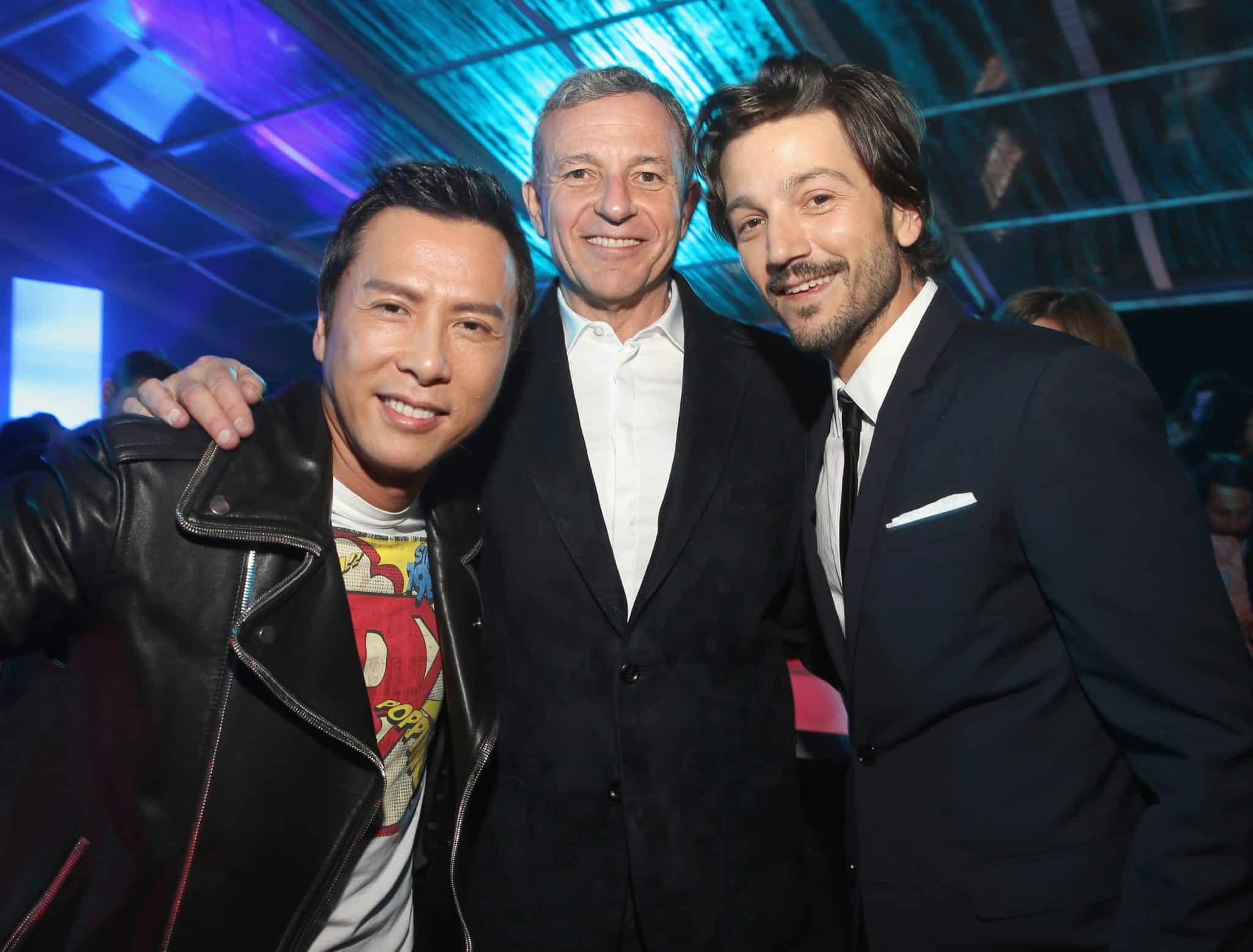 "HOLLYWOOD, CA - DECEMBER 10: (L-R) Actor Donnie Yen, The Walt Disney Company Chairman and CEO Bob Iger and actor Diego Luna attend The World Premiere of Lucasfilm's highly anticipated, first-ever, standalone Star Wars adventure, ""Rogue One: A Star Wars Story"" at the Pantages Theatre on December 10, 2016 in Hollywood, California. (Photo by Jesse Grant/Getty Images for Disney) *** Local Caption *** Donnie Yen; Bob Iger; Diego Luna"