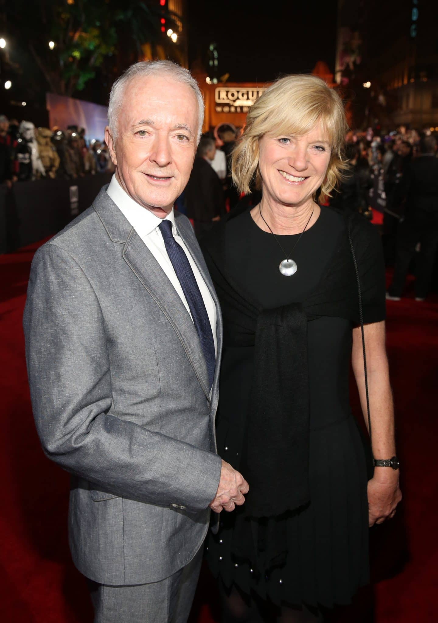 "HOLLYWOOD, CA - DECEMBER 10:  Actor Anthony Daniels and Christine Savage attend The World Premiere of Lucasfilm's highly anticipated, first-ever, standalone Star Wars adventure, ""Rogue One: A Star Wars Story"" at the Pantages Theatre on December 10, 2016 in Hollywood, California.  (Photo by Jesse Grant/Getty Images for Disney) *** Local Caption *** Anthony Daniels; Christine Savage"