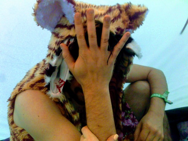 boy in a tiger hat