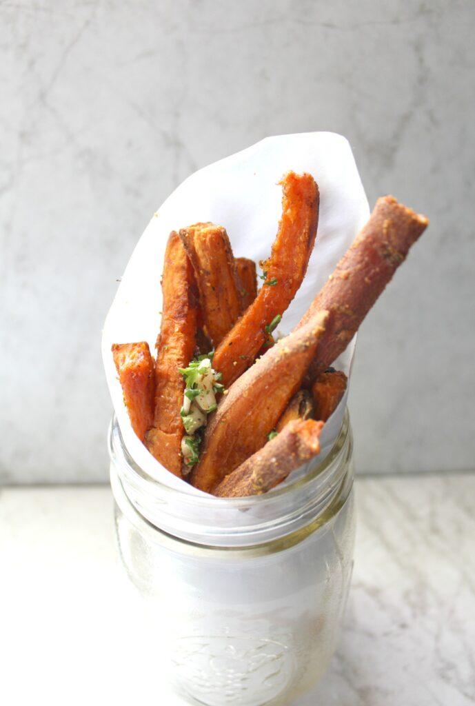 These Baked Garlic Sweet Potato Fries are a guilt free treat   VEGAN + GF   ThisSavoryVegan.com