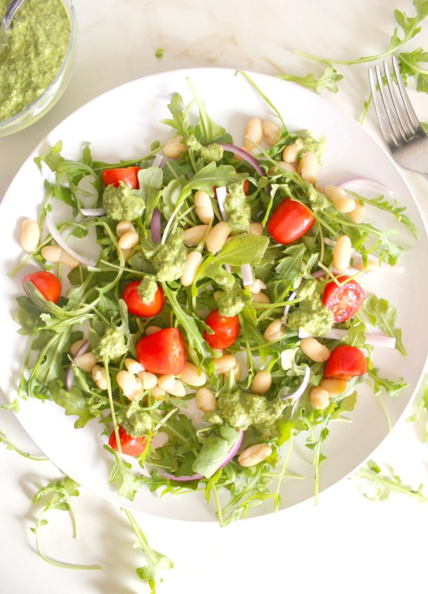 This Arugula White Bean Salad is topped with the best pesto/chimichurri dressing ever! | VEGAN + GF | ThisSavoryVegan.com
