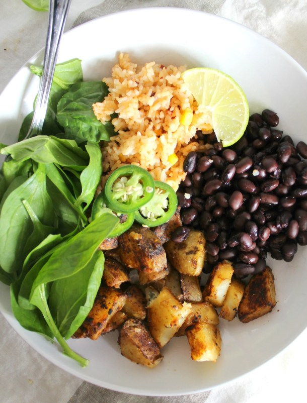 This Mexican Buddha Bowl is a healthy combo of seasoned potatoes, rice, beans and greens | VEGAN + GF | ThisSavoryVegan.com