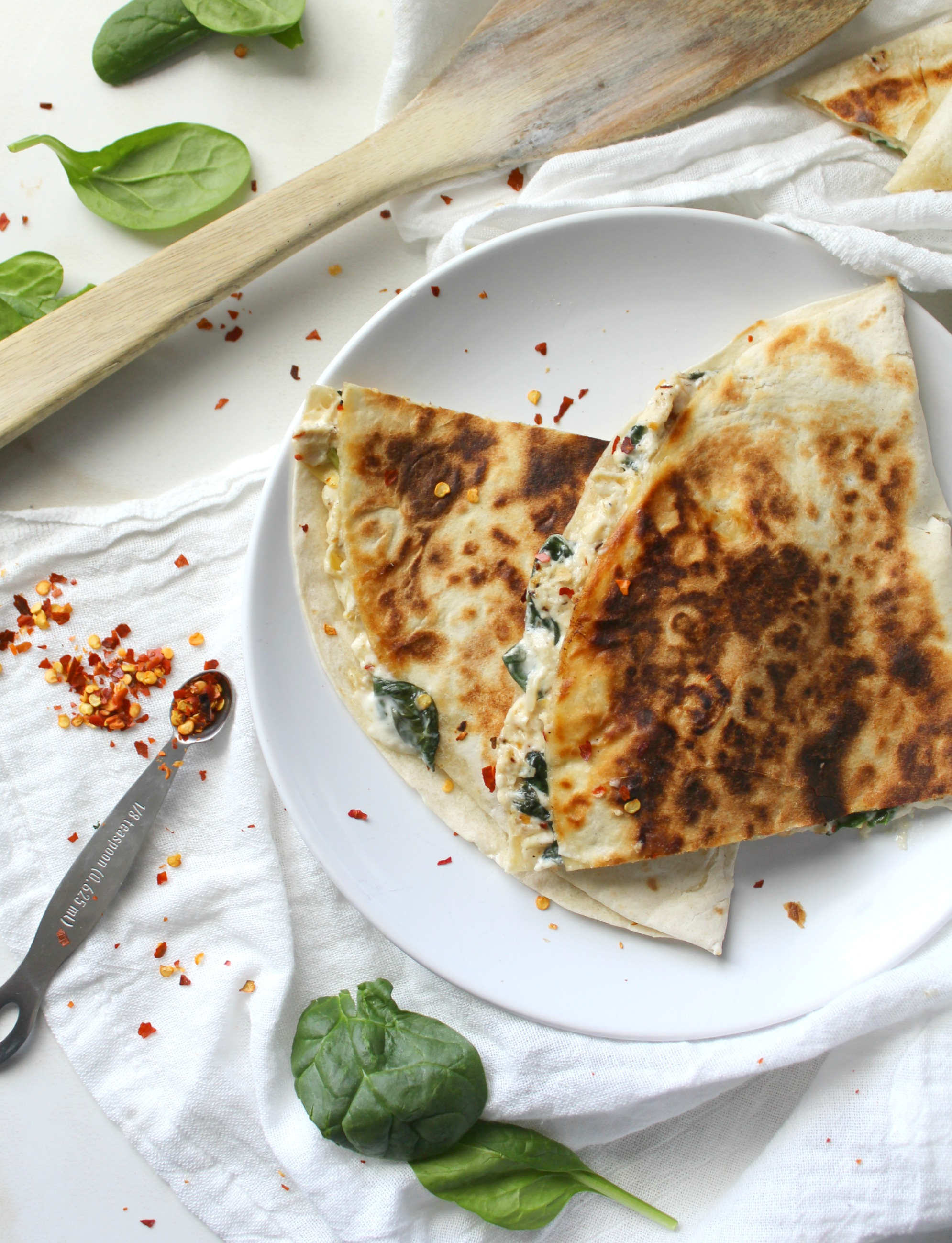 Two favorite snacks are combined into one with these Vegan Spinach Artichoke Quesadillas. These are ooey, gooey and super delicious   ThisSavoryVegan.com