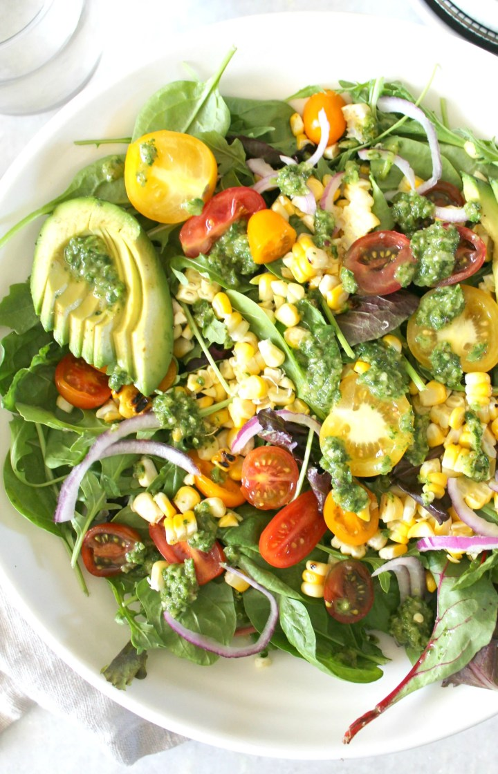 Keep it light and tasty with this Grilled Corn Summer Salad with Chimichurri Dressing. Packed full of tons of veggies and fresh flavors!   ThisSavoryVegan.com