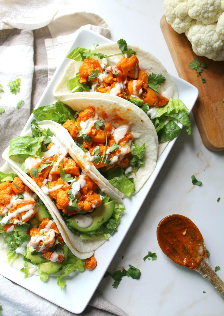 These Vegan Buffalo Cauliflower Tacos are packed full of spicy buffalo sauce, creamy ranch, crunchy romaine and hearty avocados   ThisSavoryVegan.com #thissavoryvegan #vegantacos