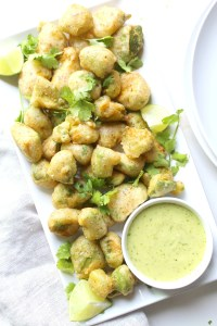 These Crispy Avocado Bites with Cilantro Jalapeño Vinaigrette are crunchy on the outside and creamy on the inside. Perfect vegan appetizer for your next party! | ThisSavoryVegan.com